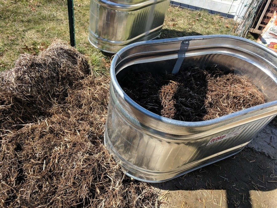 straw in water trough planters